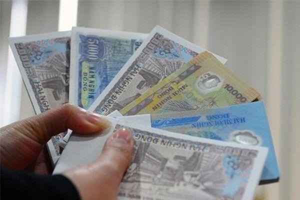 Hành vi đổi tiền lẻ để kiếm lời dịp Tết có thể bị phạt tới 80 triệu