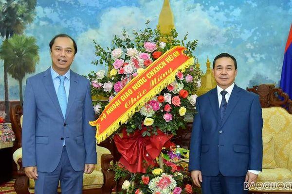 Thứ trưởng Ngoại giao Nguyễn Quốc Dũng chúc Tết cổ truyền Bunpimay Nhân dân các dân tộc Lào