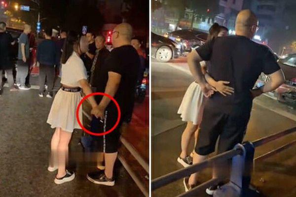 Va chạm với xe sang, cô gái mặc váy ngắn đong đưa tài xế để tránh phải bồi thường